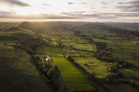 Beautiful aerial drone landscape image of Peak District countryside at sunrise on Autumn Fall morning