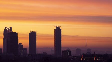 Majestic dawn sunrise landscape cityscape over London city sykline looking East along River Thames