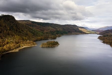 Beautiful aerial drone landscape image of glorious Autumn Fall sun over Thirlmere in Lake District
