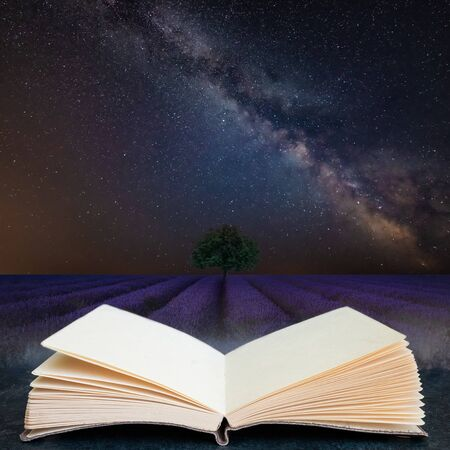 Digital composite concept image of open book wth Stunning vibrant Milky Way composite image over landscape of Beautiful lavender field Foto de archivo - 149428697