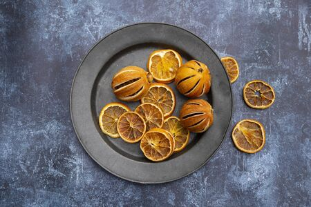 Flat lay image of dried seasonal Winter fruit on textured rough background Stock fotó