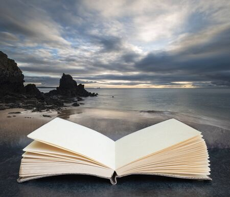 Digital composite concept image of open book wth Beautiful sunrise landscape image of Barafundle Bay on Pembrokeshire Coast in Wales
