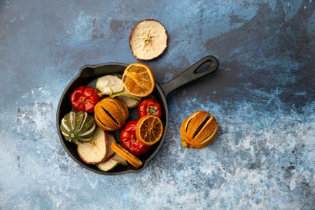 Flat lay image of dried seasonal Winter fruit on textured rough background 写真素材