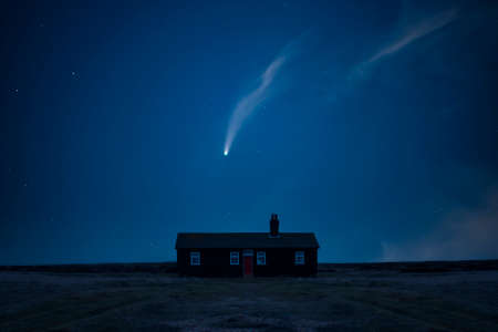 Digital composite image of Neowise Comet over Remote desolate isolated house