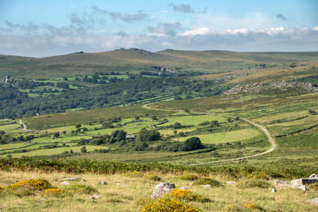 Beautiful landscape view across Dartmoor National Park in Summer with wide views of several tors and valleys