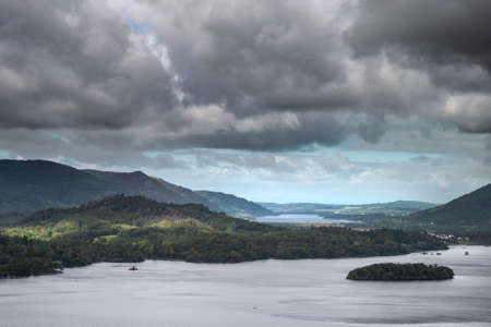Stunning dramatic landscape image of view from Surprise View viewpoint in the Lake District overlooking Derwentwater with Skiddaw and Grisedale Pike in the distance