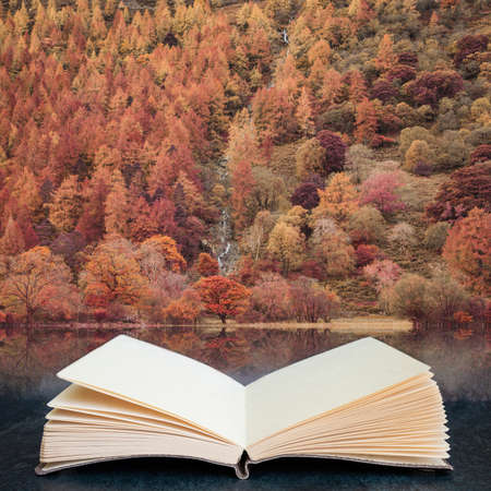 Stunning Autumn Fall landscape image of Lake Buttermere in Lake District England in pages of open fantasy book