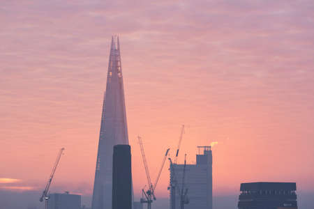 Epic sunrise over London city skyline with stunning sky formations over iconic landmarks