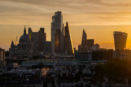 Epic landscape cityscape skyline image of London in England during colorful Autumn Fall sunrise