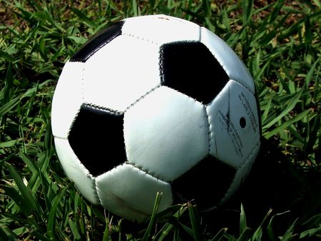 Soccer ball over the grass Stock Photo
