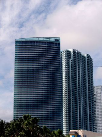 Building in Miami with glass window and Beach view photo