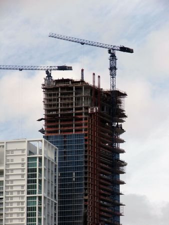 Building on construction with 2 cranes Stock Photo