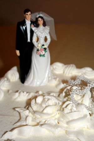 Close-up of a Wedding Cake with a wedding cake topper   photo