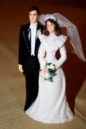 Wedding Cake Topper  over a gold table cloth Stock Photo - 3313200