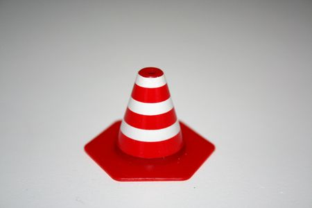 mini traffic cone with a white blackground