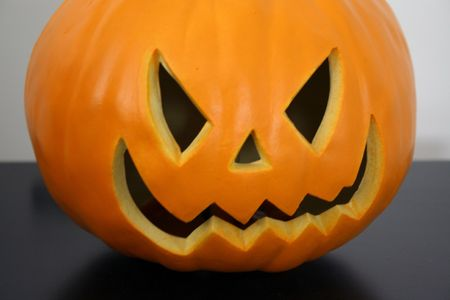 Close-up of a half Scary Halloween pumkin face Stock Photo