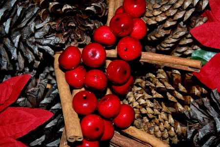 Close-up of holly, Ivy and greenery over pine cones Stock Photo