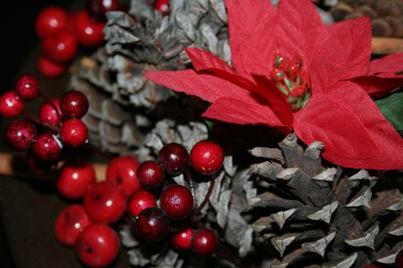 Close- up of Holly, Ivy and greenery with cones and poinsettia photo