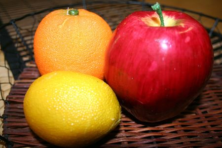 Artifitial fruits in a basket