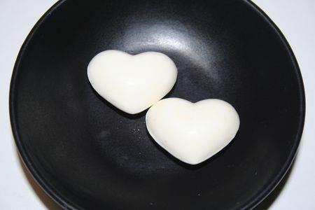 Two white hearts over a black plate Stock Photo - 4121592