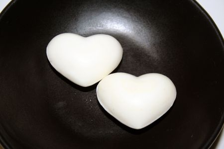 Two white hearts in a black background Stock Photo - 4121593