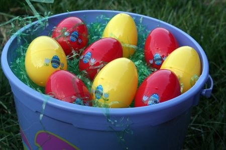 Close-up of a blue easter bucket filled with eggs photo
