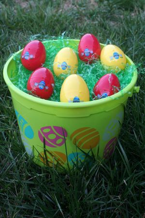 Green easter bucket filled with eggs photo