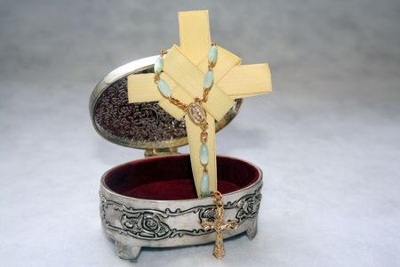 Jewelry with a cross and a rosary Banco de Imagens