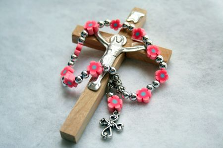 Wood cross with a mini-rosary