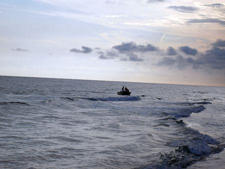 panama city beach: Barca da pesca che arrivano sul tramonto