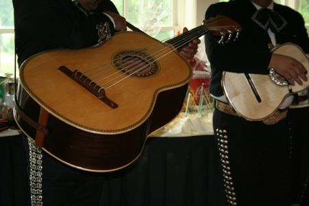 Mariachis playing guitar