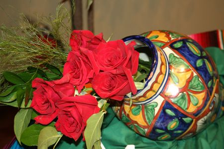 Close-up of a red roses bouquet in a Mexican vase photo