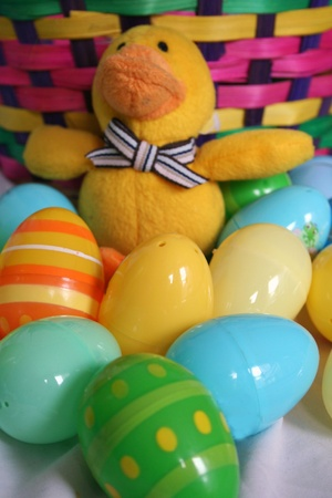 Close-up of easter eggs, basket and duck Stock Photo