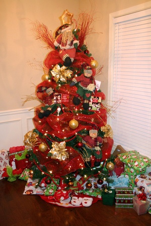 christmas tree decorated with red and gold ornaments
