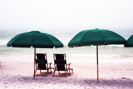 umbrella and chairs in a cloudy day in miramar beach