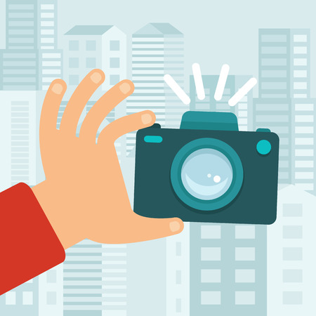 compact camera: Vector camera in flat style - taking photo