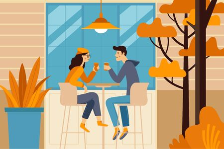 Vector illustration in flat simple style -  autumn illustration - happy couple drinking coffee - cartoon characters in coffee house Imagens - 127685975