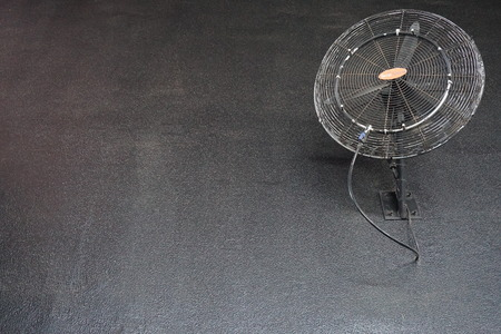 wall mounted: Wall mounted ventilator on the black wall. Stock Photo