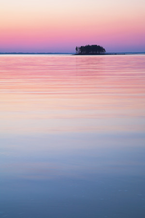 A small island on sunset background. Beautiful sky at twilight photo