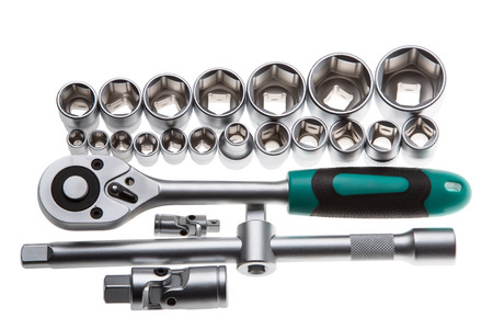 Ratchet and a set of interchangeable heads for chrome socket wrench. Isolated on white background. photo