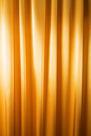 Abstract background, curtain, drapes gold fabric. Crumpled cloth, folds of fabric. photo