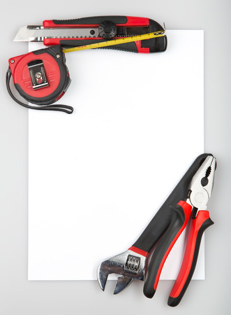tool set forming a frame on white background pliers tape measure cutting pliers - Wrench Picture Frame