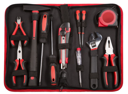 set of tools and instruments on black fabric background. pliers, cutter, screwdriver, wrench and tape measure. Stockfoto