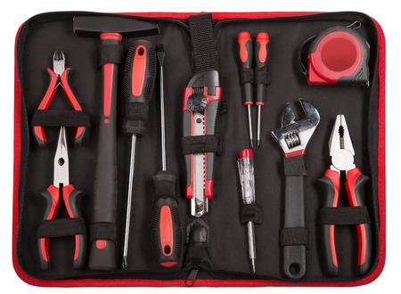 set van hulpmiddelen en instrumenten op zwarte stof achtergrond. tang, mes, schroevendraaier, moersleutel en meetlint. Stockfoto