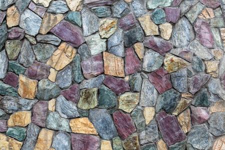 stones: Abstract texture of the stone masonry colored stone. Stone wall, stone texture.