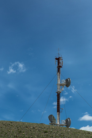 telecommunications tower cellular television toweron blue sky background