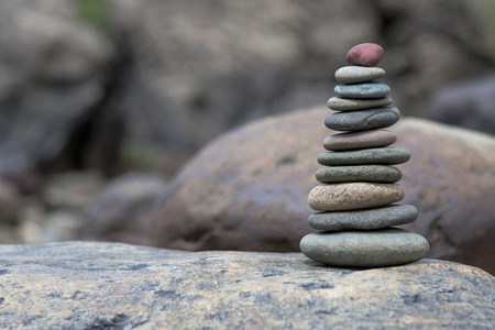 pebbles: Stack of pebbles. Pyramid of stones on the shore