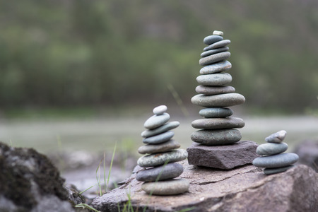 Stack of pebbles. Pyramid of stones on the shore