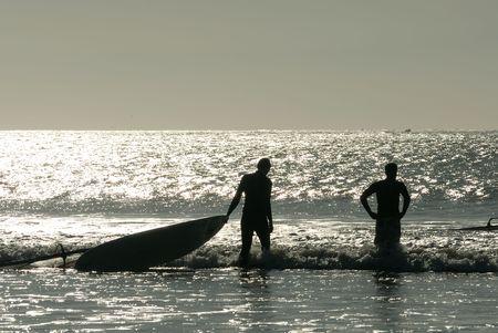 Surfers in the ocean, Essaouira, Morocco photo