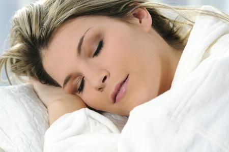 Beautiful woman sleep on the white background photo